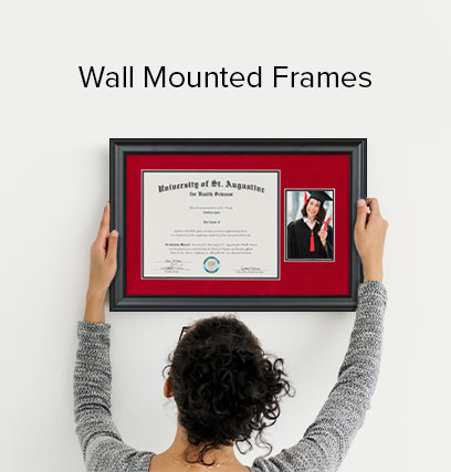 Woman hanging a diploma, in a red and black frame; on her wall.