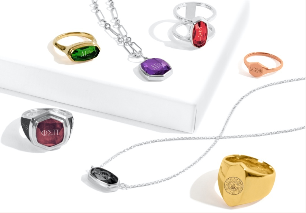 An assortment of Kendra Scott Greek jewelry styles including rings and necklaces.