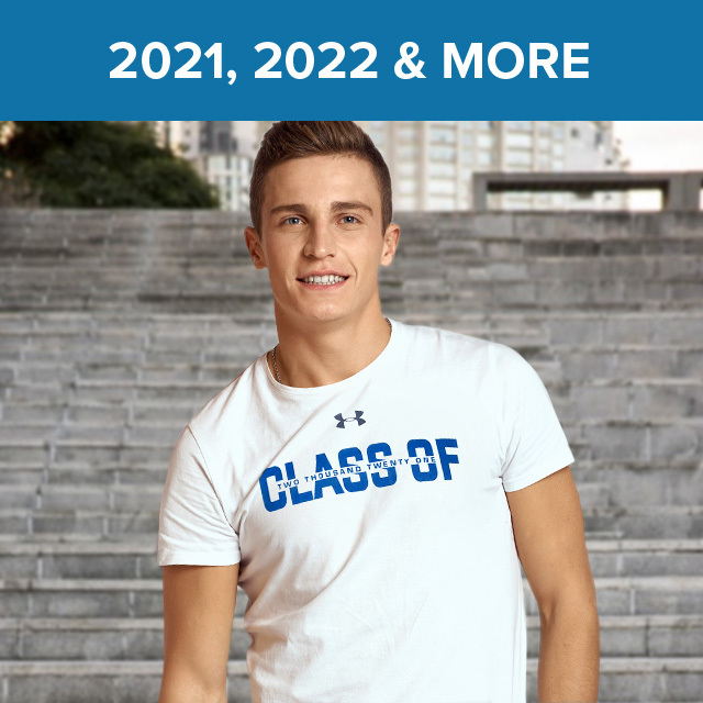 """A smiling male Senior in a white UnderArmour? T - shirt with """" Class of Two Thousand Twenty One """" in blue lettering."""