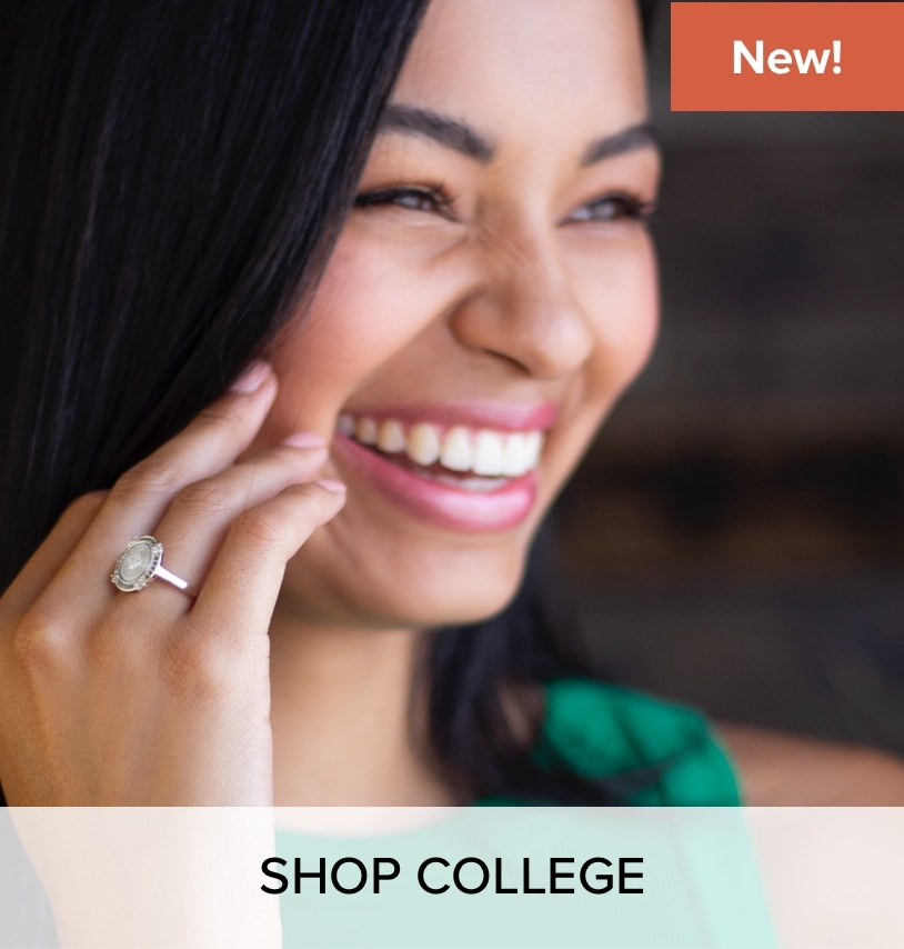 A woman wearing a University Collection ring.