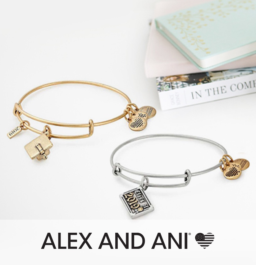 Alex and Ani Bracelets, next to text books; and a notebook.