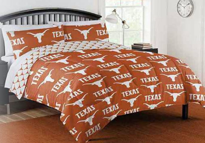University of Texas comforter set, on a bed; inside of a dorm room with matching rug and curtains