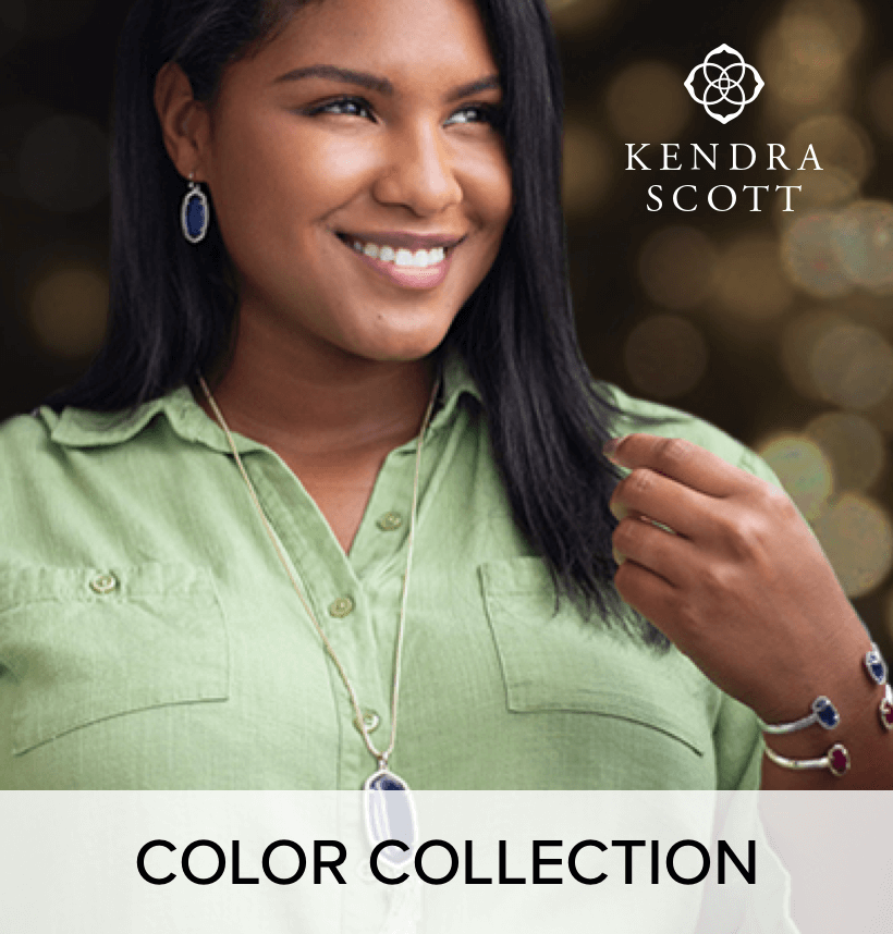 A woman wearing matching; Kendra Scott color collection, earrings, necklace, and bracelets.