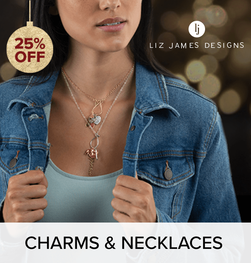 Woman in a denim jacket, wearing Liz James charm  necklaces.
