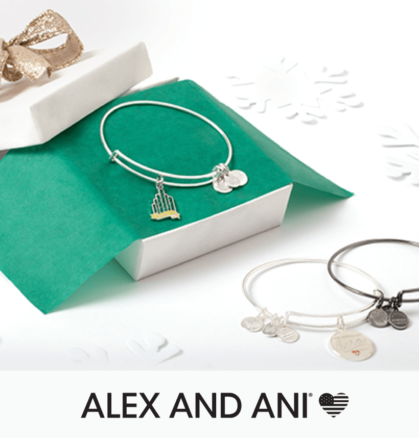 A alex and Ani necklace, in a gift box; next to two other Alex and Ani necklaces.