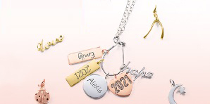 Mixed metal charms in a variety of designs, including luck, religious, name and grad year charms.