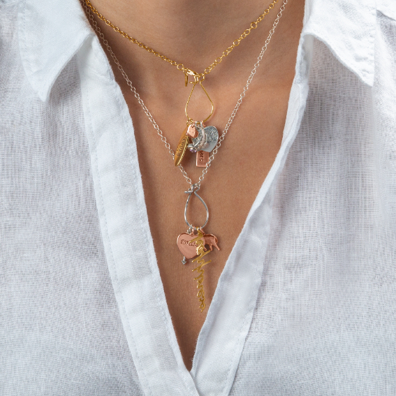 a woman wearing Storyteller, Curated Collection necklaces