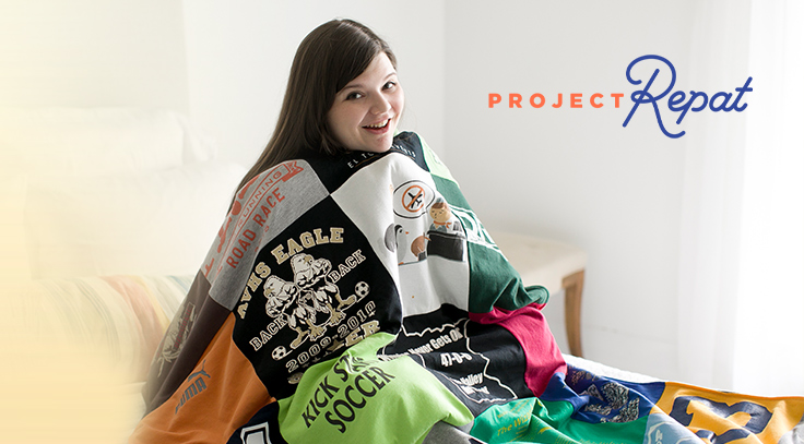 A woman sitting on her bed with, a custom t-shirt quilt; made from her favorite tee shirts