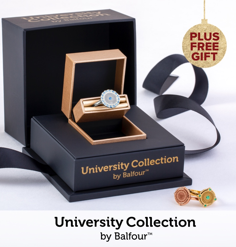 A University Collection ring, presented; inside of a decorative double gift box, with a ribbon. Next to the box are two other university collection rings