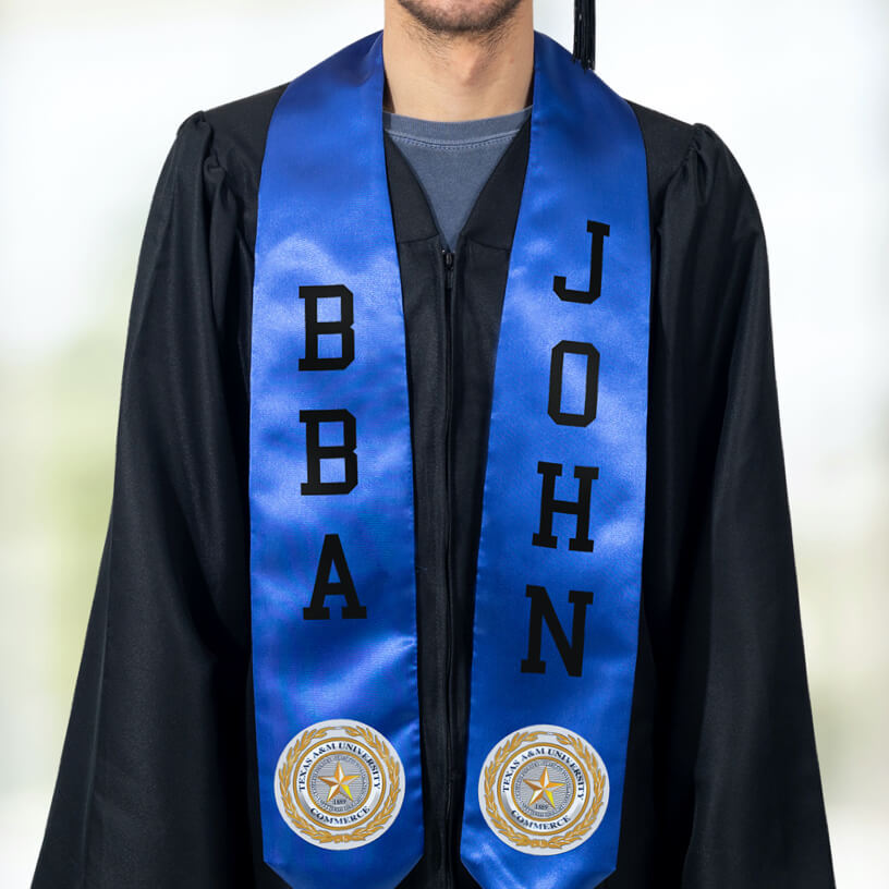A graduate in a black graduation gown wearing a blue stole with FlexStyle® official college patches and text.