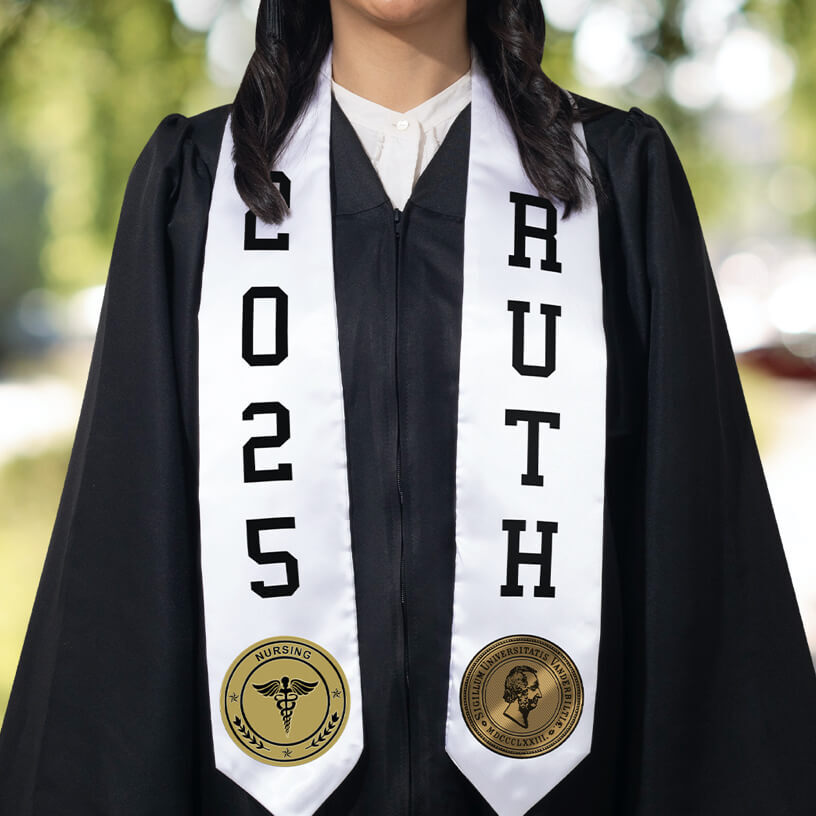 A graduate in a black graduation gown wearing a white stole with FlexStyle® official college patches and text.
